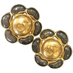 Vintage CHANEL large flower earrings with CC and gunmetal color gripoix stones.