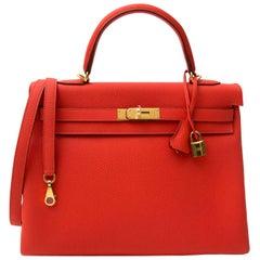 Hermès Kelly 35 Togo Capucine GHW Bag and Strap