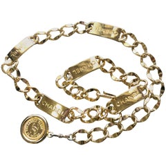 MINT. 80's Vintage CHANEL golden thick chain belt with logo engraved bar motifs.