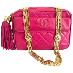 Chanel CC pink leather camera bag style Vintage shoulder bag with tassel