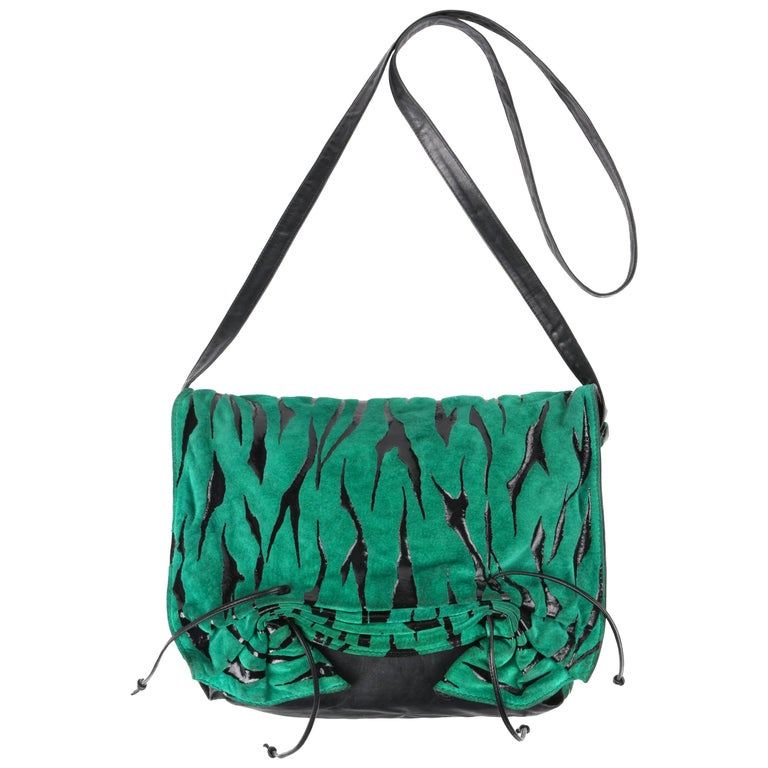 Vintage Carlos Falchi c.1980's green tiger stripe seude leather pleated crossbody bag. Green and black suede leather tiger stripe flap front with pleated cinched detail at bottom and two thin leather ties. Black leather body. Thin leather crossbody