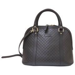 Gucci GG Monogram black leather shoulder bag