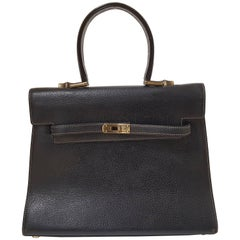 "Moschino ""Kelly"" Black leather bag"