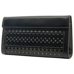 6caf37a61d05 Alaia Black Perforated Leather Studded Small Clutch Bag