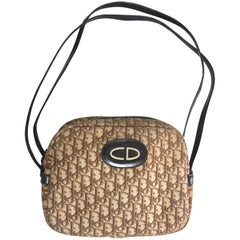 Vintage Christian Dior brown trotter jacquard handbag with logo motif.
