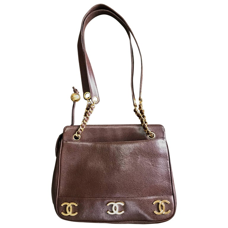 Vintage CHANEL brown caviar leather chain shoulder bag with 3 golden CC marks.
