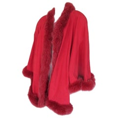 Suede leather coral color cape with fox fur