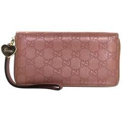 Gucci Pink Embossed Monogram Leather Zip Around Wristlet Wallet