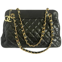 Vintage CHANEL black lambskin large tote bag with gold tone chains and jumbo CC.