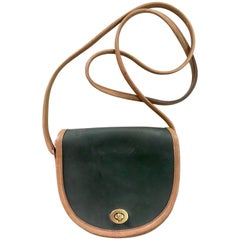 Vintage COACH genuine khaki and brown leather mini shoulder bag.