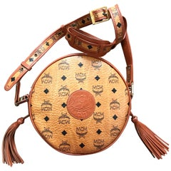 Vintage MCM brown Suzy Wong round shoulder bag with fringes. Michael Cromer.