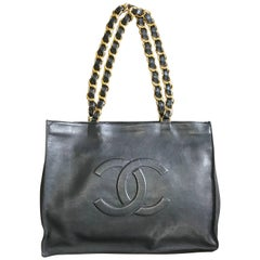Chanel Vintage black calfskin large tote bag with gold tone chain handles and CC