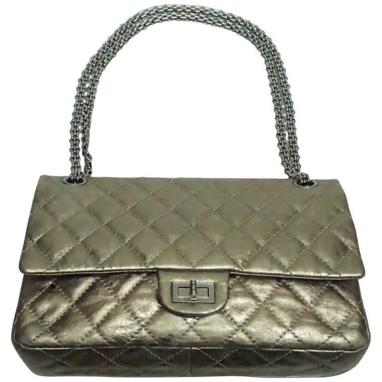 Chanel Bronze Metallic Lambskin 2.55 Double Flap - SHW - 226 size This beautiful reissue bag has the mademoiselle lock and chain in SHW. It is a spectacular metallic bronze lambskin. The bag is in very good condition. Circa 2006/2007.  Measurements: