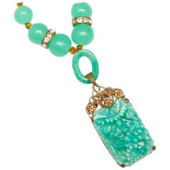 1920s Peking Glass Pendant Necklace With Gold Tone Filigree Setting and Crystal