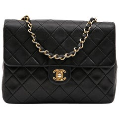 CHANEL Vintage Mini Bag in Black Quilted Lambskin Leather