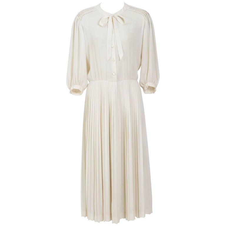 Nina Ricci 1970s cream crepe georgette pleated skirt pussy bow dress