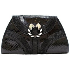 Bvlgari Python Embellished Lion Head Clutch Bag