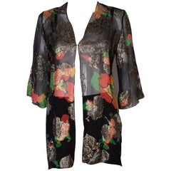 A Vintage 1980s lurex floral evening jacket by Caroline Charles