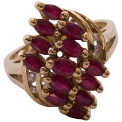 A Ruby and Diamond Dress Ring with Yellow Gold Band.
