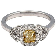 0.50ct Radiant Natural Yellow Diamond Ring with white pave diamonds in 18K