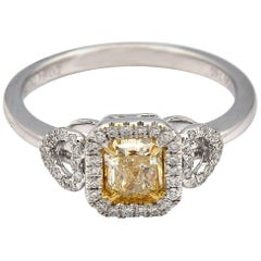 0.64 Carat Radiant Natural Yellow Diamond Ring in 18 Karat White Gold