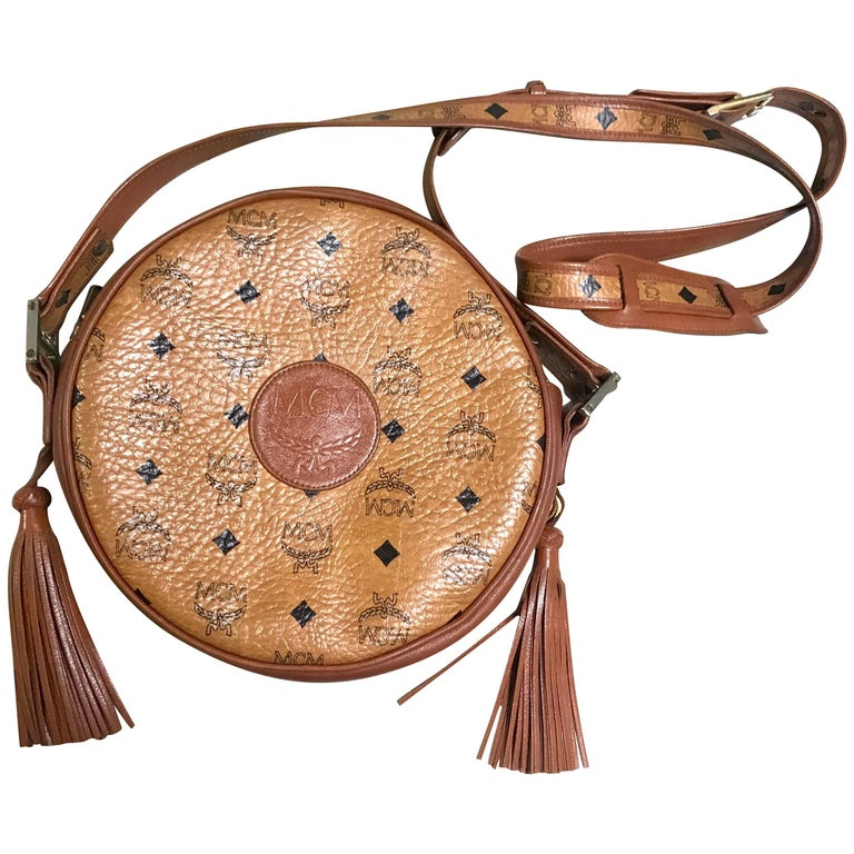 Vintage MCM brown monogram round Suzy Wong shoulder bag with fringes. Classic
