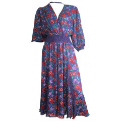 Diane Freis Floral Dress is Size Small.