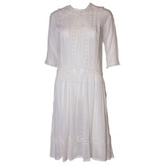 A Vintage edwardian lawn cotton dress with delicate embroidered flowers