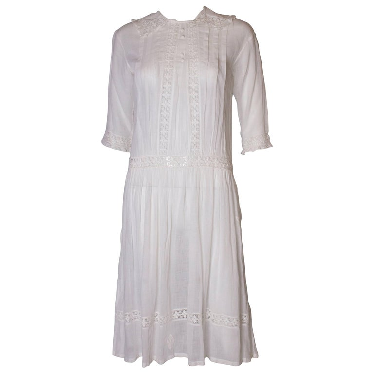 A Vintage edwardian lawn cotton dress with delicate embroidered flowers  For Sale