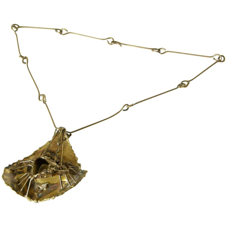 Brutalist Brass Necklace with Sculptural High Relief Pendant For Sale