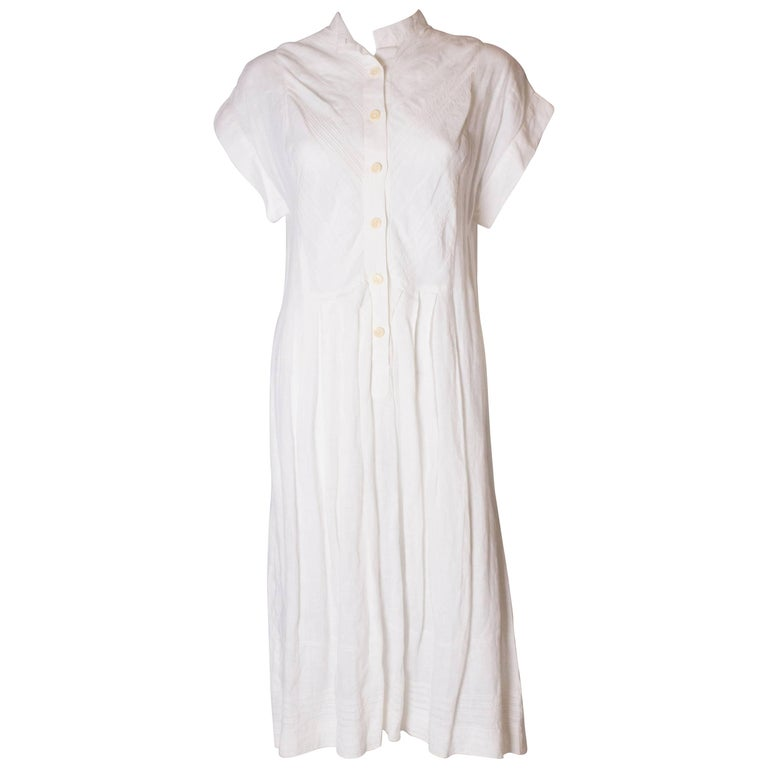A Vintage 1980s white linen button front day summer dress by Gucci