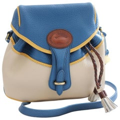 Dooney & Bourke French Blue Palomino Bone Teton Drawstring Saddle Bag