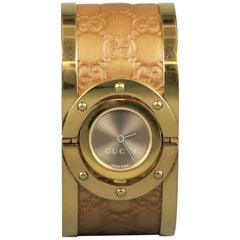 Gucci Gold Metal Monogram Leather Twirl Collection Wristwatch