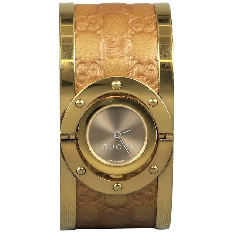 90eb6e0df80 Gucci Gold Metal Monogram Leather Twirl Collection Wristwatch at 1stdibs