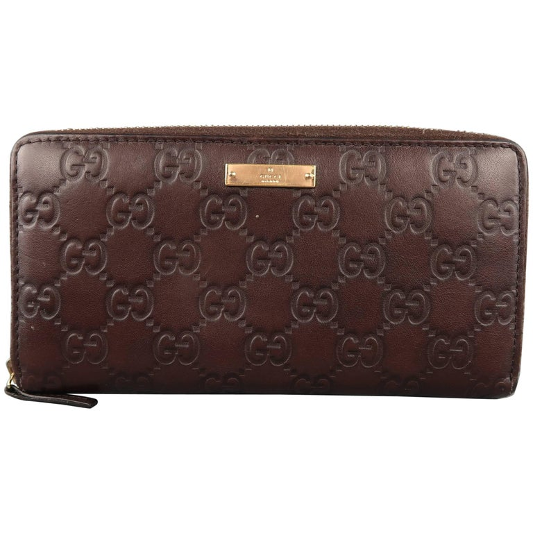 b428f2fe338 Gucci Brown Monogram Embossed Leather Zip Pocket Book Wallet at 1stdibs