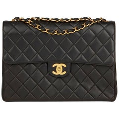 1994 Chanel Black Quilted Lambskin Vintage Jumbo Classic Single Flap Bag