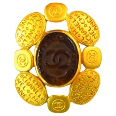 Chanel 1990s Vintage CC Logo and Amber Glass Brooch Pin