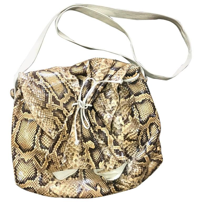 Vintage Carlos Falchi beige and brown snakeskin large messenger shoulder bag.