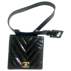 Vintage CHANEL black patent enamel chevron, V stitch fanny pack with golden CC.