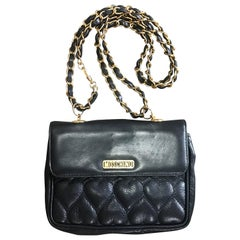 Vintage MOSCHINO black heart shape stitch shoulder bag, fanny pack with chains.