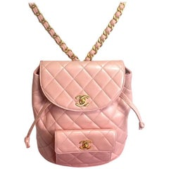 Vintage CHANEL quilted pink lamb backpack with golden CC and chain straps.