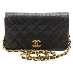 """Vintage Chanel 7.5 """" Flap Black Quilted Leather Mini Shoulder Bag"""