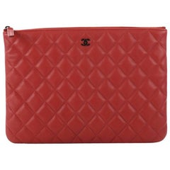 Chanel Quilted Lambskin Medium O Case Clutch