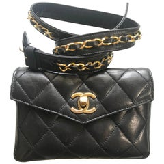 Vintage CHANEL black lamb waist bag, fanny pack with golden chain belt & CC.