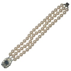 Silver Tone Faux Pearl Vintage Bracelet with a Blue and Clear Rhinestone Clasp