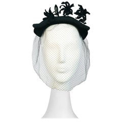 1950s Black Velvet Cocktail Hat with Veil and Flower Embellishments