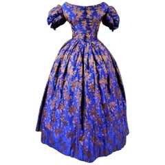 Deep blue brocaded silk crinoline ball-gown – Circa 1850