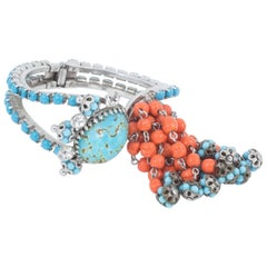 Prong set silvertone,turquoise and coral glass clamper 'cha cha' bracelet 1950s