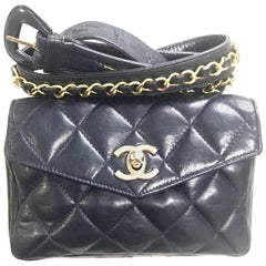 Chanel Vintage navy lamb waist bag fanny pack with golden chain belt and CC.