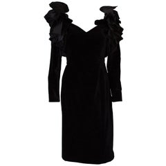 A Vintage 1980s dramatic sleeve black cocktail dress by Gina Fratini